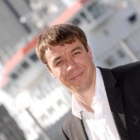 A professional headshot photograph of Steve Brand taken from his LinkedIn Profile